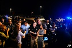 Louisiana Gov. Bobby Jindal, center, speaks with the media following a deadly shooting at the Grand Theatre in Lafayette, La., July 23, 2015.