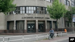 The Alexander-von-Humboldt Gymnasium in Berlin is seen on Monday July 6, 2009. The school has been closed due to an outbreak of the swine flu. (AP Photo/Fritz Reiss)