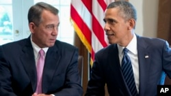 President Barack Obama talks with House Speaker John Boehner of Ohio earlier this month.