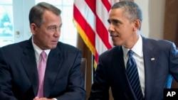 President Barack Obama talks with House Speaker John Boehner of Ohio earlier this month.