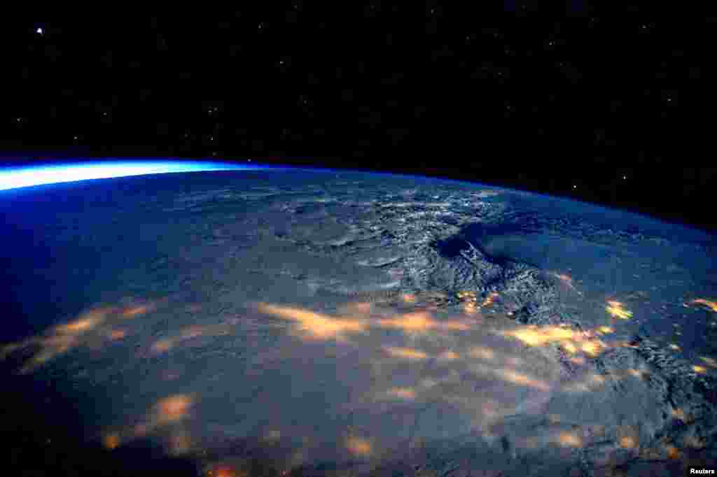 A winter storm affecting the U.S. East Coast is seen in a NASA picture taken from the International Space Station, Jan. 23, 2016.The storm dumped nearly 2 feet (58 cm) of snow on the suburbs of Washington, D.C., before moving on to Philadelphia and New York, paralyzing road, rail and airline travel along the U.S. East Coast.