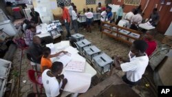 FILE - Election workers at a voting station set up in a government office building in Port-au-Prince, Haiti.