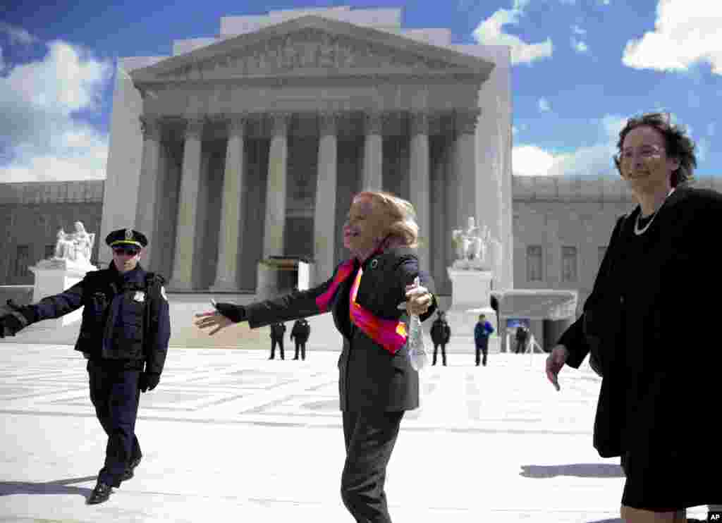 Plaintiff Edith Windsor looks to supporters in front of the Supreme Court in Washington, March 27, 2013.