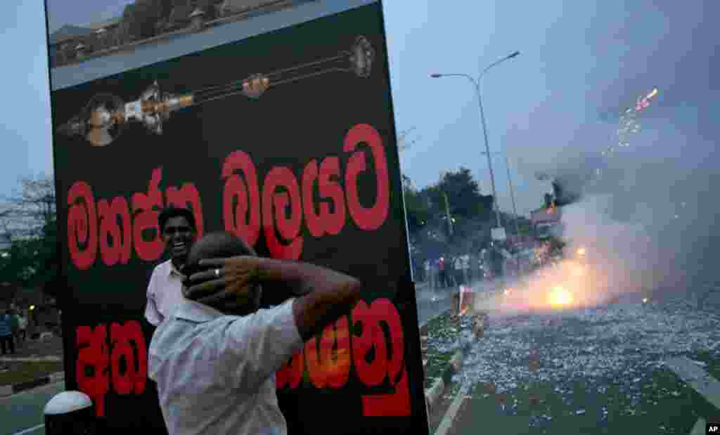 Supporters of Sri Lanka's President Mahinda Rajapaksa light firecrackers to celebrate after hearing the result of a vote to impeach the country's Chief Justice Shirani Bandaranayake in Colombo, Sri Lanka. Parliament voted overwhelmingly to impeach the justice, deepening a standoff between the judiciary and the government, which is controlled by the country's most powerful family.