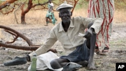 Gatdin Bol, 65, who fled fighting and now survives by eating fruit from the trees, sits under a tree in the town of Kandak, South Sudan, May 2, 2018.