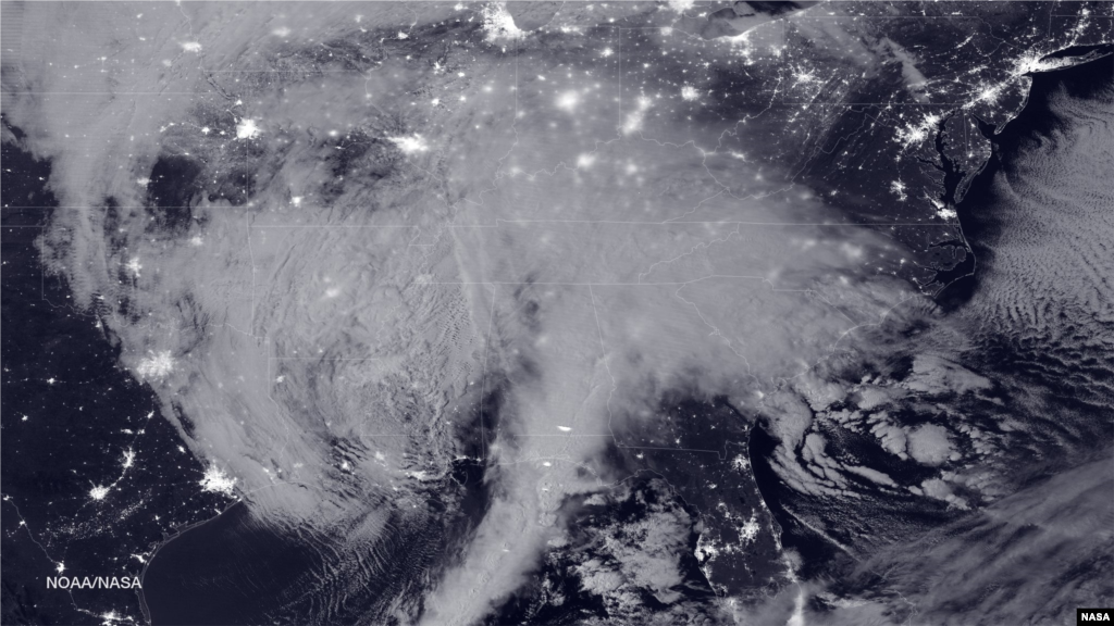 NASA and NOAA satellites are tracking the large winter storm that is expected to bring heavy snowfall to the U.S. mid-Atlantic region on Jan. 22-23. NASA-NOAA's Suomi NPP satellite snapped this image of the approaching blizzard around 2:35 a.m. EST, Jan. 22, 2016.