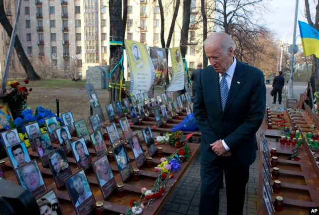 U.S. Vice President Joe Biden pays his respects at a memorial honoring dozens of demonstrators killed during 2013-1014 anti-government protests in Kyiv, in Ukraine's capital, Dec. 7, 2015.