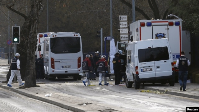 Forensic experts arrive near the site of last night's explosion in Ankara, Turkey, Feb. 18, 2016.