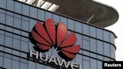 FILE PHOTO: The Huawei logo is pictured outside its Huawei's factory campus in Dongguan, Guangdong province, China, March 25, 2019.