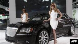 Models pose with the new Chrysler 300 at the North American International Auto Show in Detroit.
