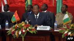 The president of Burkina Faso, Blaise Compaore, speaks during ECOWAS talks on Mali on July 7, 2012, in Ouagadougou.