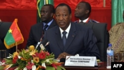 FILE - The president of Burkina Faso, Blaise Compaore, speaks during ECOWAS talks in Ouagadougou, July 7, 2012. The longtime ruler abruptly stepped down Oct. 31, 2014, in the face of protests against his efforts to change the constitution and allow him to run for re-election next year.