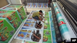 A Palestinian prints posters in preparation for a prisoner swap between Hamas and Israel, in Gaza City, October 16, 2011.