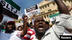 A group of Sri Lankan Muslims shout slogans, protesting against the UN and U.S resolution against Sri Lankan war crimes, during a demonstration as they march towards U.S embassy in Colombo, March 26, 2014.