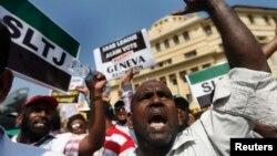 斯里兰卡穆斯林2014年3月在科伦坡举行的一次示威中抗议联合国和美国针对斯里兰卡战争罪行的决议。
