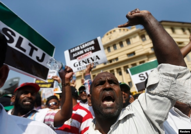 FILE - A group of Sri Lankan Muslims shout slogans, protesting against the U.N. and U.S resolution against Sri Lankan war crimes, during a demonstration as they march toward the U.S. embassy in Colombo, March 26, 2014.