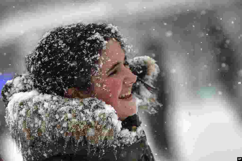 Snow covers a teenager's face in Pamplona northern Spain.