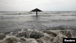 FILE - Waves are seen crashing ashore at Mayangan village in Subang in Indonesia's West Java province.