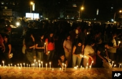 FILE - People hold a candlelight vigil for the victims of a terrorist attack, in Mumbai, India, Nov. 29, 2008. The attack took a total of 160 lives.