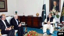 In this handout photograph released by the Press Information Department (PID) on May 3, 2017, Pakistan's Prime Minister Nawaz Sharif (R) meets with Iranian Minister of Foreign affairs Mohammad Javad Zarif (2L) at the Prime Minister's House in Islamabad.