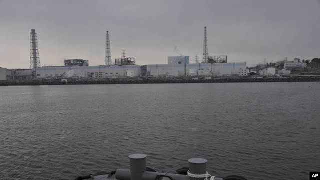 Tokyo Electric Power Co.'s Fukushima Daiichi Nuclear Power Plant is seen from a Japan Maritime Self-Defense Force vessel off Fukushima Prefecture, northeastern Japan, in this photo taken on March 31 and released by Japan Defense Ministry April 1, 2011