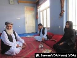 VOA reporter Ayesha Tanzeem, right, meets with a Shinwari tribal elder in Jalalabad, Afghanistan.