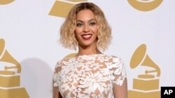 FILE - This Jan. 26, 2014 file photo shows Beyonce at the 56th annual Grammy Awards in Los Angeles.