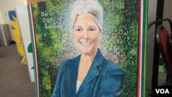A painting of presumptive presidential nominee Jill Stein is displayed in the registration room at the Green Party's nominating convention in Houston, Aug. 5, 2016. (G. Flakus/VOA)