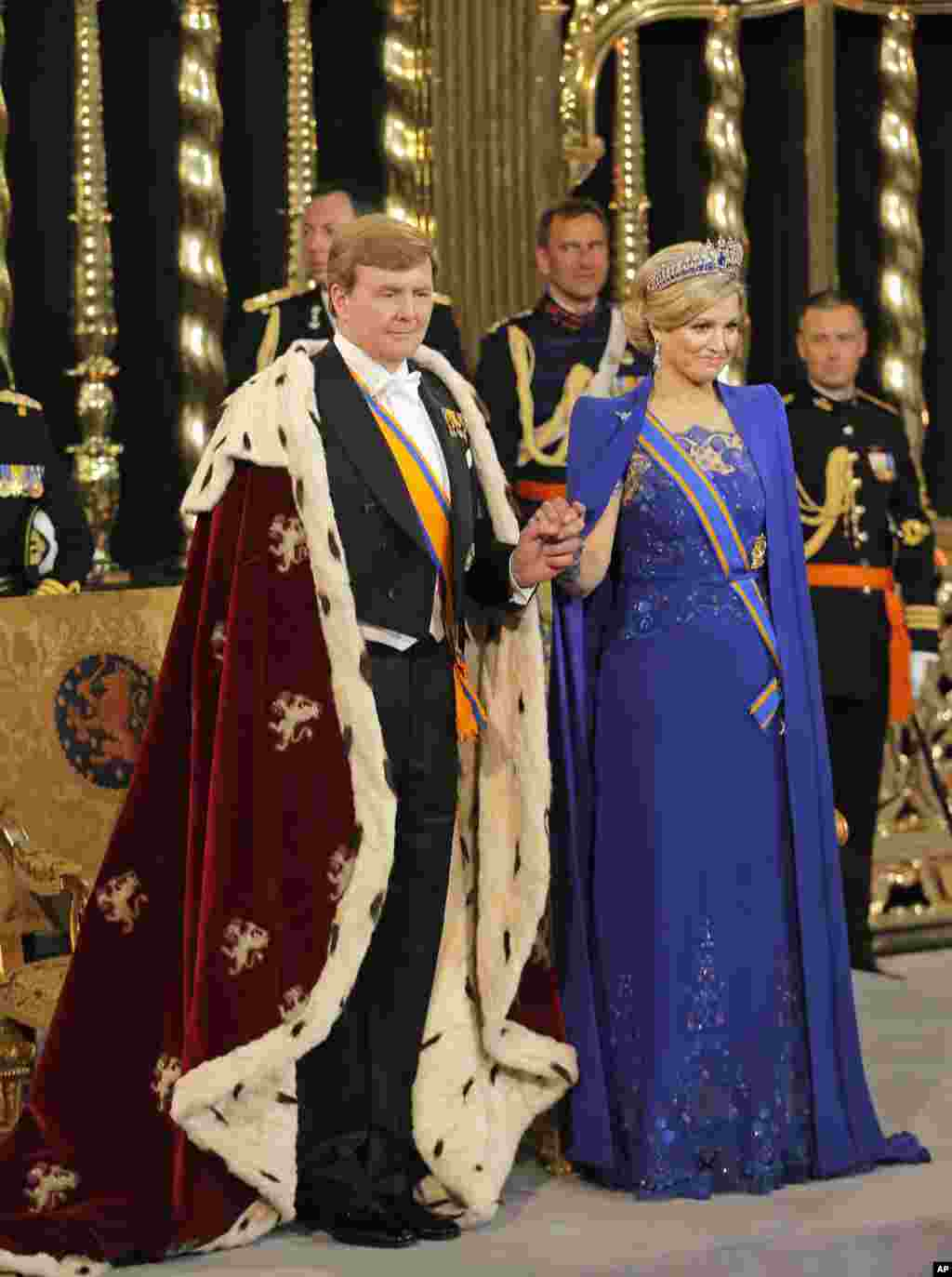 Dutch King Willem-Alexander and Queen Maxima stand inside the Nieuwe Kerk or New Church in Amsterdam, at his investiture, April 30, 2013.
