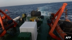 FILE - Image from a Vietnam Coast Guard ship on May 13, 2014 shows a covered gun-machine on the deck during a patrol near China's oil drilling rig in disputed waters in the South China Sea.