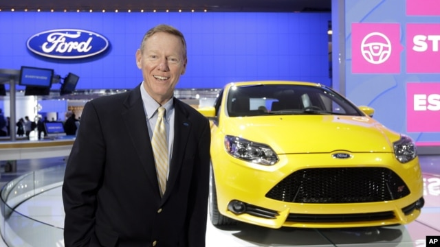 Ford President and CEO Alan Mulally stands by a Ford Focus during the North American International Auto Show in Detroit, January 15, 2013. (AP Photo/Carlos Osorio)