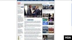 美国防部网页公布卡特 与杨念祖握手照片(美国之音钟辰芳)