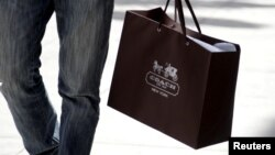 FILE - A shopping bag from the luxury brand Coach is seen along Rodeo Drive in Beverly Hills, California, May 21, 2013.