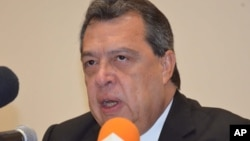Angel Aguirre, governor of the state of Guerrero announces he's stepping aside during a press conference in Chilpancingo, Mexico, Thursday Oct. 23, 2014.