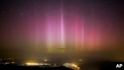 FILE - The Northern Lights (Aurora borealis) are seen on the sky above Pilisszentkereszt, north of Budapest, Hungary, on March 18, 2015. Parts of Britain and Germany have been treated to a display of the northern lights, a colorful phenomenon that is usually only seen further north.