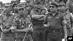 Maj. Gen. Suharto, 2nd left with sunglasses, is shown in this Oct. 6, 1965 file photo. The late dictator was an army general who crushed Indonesia's communist movement and pushed aside the country's founding father to usher in 32 years of tough rule.