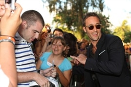 "Star Alex O'Loughlin (right) celebrates the second season premiere of ""Hawaii Five-0"" with fans in Honolulu on Sept. 10."