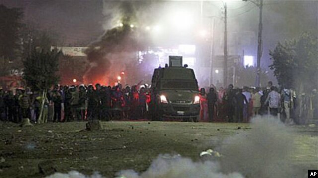 Police fire teargas towards voters who protested, claiming they were prevent from casting their votes in Damas village near El Dakahlia, Egypt, Dec. 5, 2010