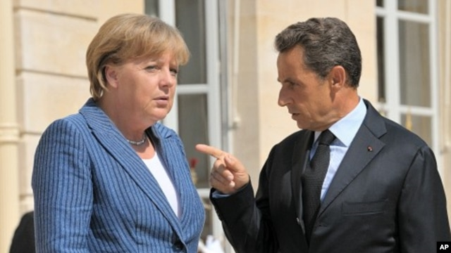 France's President Nicolas Sarkozy welcomes German Chancellor Angela Merkel as she arrives for a meeting at the Elysee Palace in Paris, August 16, 2011