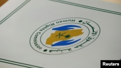 FILE - A folder with a logo of the Human Rights Commission of Saudi Arabia is pictured on a desk during the Universal Periodic Review of Saudi Arabia by the Human Rights Council at the United Nations Office in Geneva, Switzerland.
