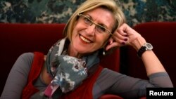 Rosa Diez, leader of the centrist Union for Democracy and Progress, or UPyD, smiles while posing for a photograph in Parliament in Madrid, May 21, 2013.