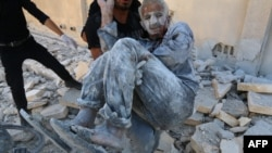 FILE - Syrian civil defense workers rescue a man from under the rubble after a Syrian government helicopter allegedly dropped a barrel bomb on the Sakhour eastern neighborhood, in the northern city of Aleppo, July 25, 2014.
