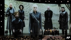 """FILE - """"Game of Thrones"""" cast and crew members accept the Emmy Award for Best Drama onstage at the 70th Primetime Emmy Awards in Los Angeles, Sept. 17, 2018."""