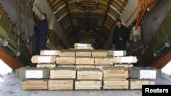 Boxes of ammunition are seen inside a Russian aircraft at the International Kabul Airport, Afghanistan, Feb. 24, 2016. Afghan officials took delivery of 10,000 automatic rifles and millions of rounds of ammunition as a gift from Russia.