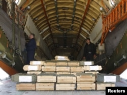 FILE - Boxes of ammunition are seen inside a Russian aircraft at the International Kabul Airport, Afghanistan, Feb. 24, 2016. Afghan officials took delivery of 10,000 automatic rifles and millions of rounds of ammunition as a gift from Russia.