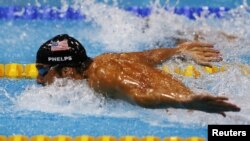 FILE - Michael Phelps of the U.S. swims the butterfly leg of the men's 4x100m medley relay final during the London 2012 Olympic Games, Aug. 4, 2012.