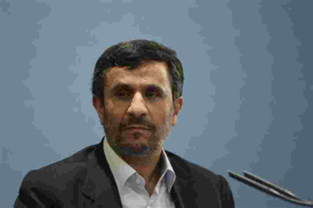 Iranian President Mahmoud Ahmadinejad, gestures, as he speaks with media during his press conference in Tehran, Iran, Monday, April 4, 2011. The president says crude oil prices, now above $108 a barrel, are low, and will reach $150 soon. Oil prices jumped