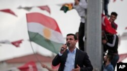 Ahead of Sunday's election, Selahattin Demirtas, head of the pro-Kurdish Peoples' Democratic Party (HDP), delivers a speech from the top of his election campaign bus at a rally in Istanbul, Turkey, June 6, 2015.
