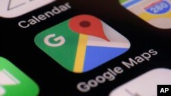 This photo taken March 22, 2017, shows the Google Maps app on a smartphone in New York. Google is enabling users of its digital mapping service to allow their movements to be tracked by friends and family in the latest test of how much privacy people are willing to sacrifice.