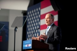 FILE - Democratic presidential candidate Mike Bloomberg holds a campaign rally in Salt Lake City, Utah, Feb. 20, 2020.